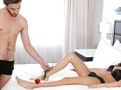 Ariana Marie lays in bed decked out in a bra, panties, and blindfold that are all the same deep blue. Her breath comes in short gasps as Lucas Frost caresses her skin with the petals of a rose, then leans forward to replace the flower with his lips. Removing Ariana's bra, Lucas takes the time to tenderly explore each of her tan lined breasts and small hard nipples before shifting his attention lower on Ariana's body.When Logan peels off Ariana's panties and slides his tongue down her slit, her breath hitches in expectation. Lucas doesn't disappoint, settling in for a trimmed pussy feast that splits his focus between Ariana's clit and twat. Winding his fingers through Ariana's hands, Lucas sucks her meaty folds into his mouth and applies the perfect amount of pressure with his lips and tongue.When Lucas releases Ariana from her blindfold, she is ripe with sexual need and eager to please. She pushes her boyfriend down on the bed, relieving him of his briefs and taking his long dick in her hand. Sucking slowly and steadily, she enjoys a languorous blowjob as she gradually works her way up to deep throating Lucas as deep as she can take him.Since deep is the name of the game on multiple levels, Ariana abandons her sucking and swings one leg over her lover's hips to straddle him. With Lucas's hand acting as a guide, Ariana slides down on his fuck stick and leans forward for a kiss once she's fully impaled. Moving her slender figure in a primal rhythm, she works her hips until she can't keep from moaning her delight.When Ariana switches spots with Lucas and lays on her belly, she shivers with excitement at his touch on her back and bottom as he comes up behind her. Sliding into Ariana from behind, Lucas delivers long strokes that touch every inch of his girlfriend form the inside out. He pauses to lick and kiss Ariana's bubble butt before going back to work for her pleasure.Flipping onto her back and spreading her thighs wide to cradle Lucas at the heart of her pleasure, Ariana closes her eyes and cries out her delight as her pussy pulses. Lucas slides deep and fast, hooking one hand around Ariana's thigh to bring her to one final climax. Moments later, he pulls out and takes aim at hid lover's tits to leave her covered in the hot evidence of his love.