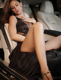 Beautiful brunette Caprice is dressed-up for a night on the town in a black silk designer gown. Sitting inside her luxury car, Caprice tires of waiting for her lover Marcello to fetch her purse. She lifts her dress high allow her hands access to her inner thighs and pussy - but just then she hears Marcello approaching the car. She covers up quickly. As he climbs into the driver's seat, Caprice gives him a little unexpected slap across his face, his punishment for making his Lady wait. She takes control, grabs his head and kisses him passionately. Leaning in, her dress hikes up over her hips revealing her perfect pussy. His cock stands at attention as she unzips his pants . After several minutes of a mind-bending blowjob, Caprice climbs atop Marcello, straddling him as he plunges his cock inside her. You can see the pink folds of her pussy, forced open with each stroke as he fucks her deeply. Two lovers turn an ordinary night on the town into an awesome opportunity to fuck! Produced and shot by Brigham