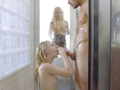 Tyler Nixon and Lily Rader are enjoying a sexy time in the shower, with Tyler using the slickness of the soap to really get Lily's motor running. Turning Lily around so that she faces the wall, Tyler rubs her soft skin down. Then he stands beneath the spray as Lily drops to her knees to deep throat his cock in a wet warm blowjob. It's only natural that he will return the favor, going down on his knees so that he can press his mouth into Lily's delightful twat.That's when Elsa Jean walks into the room. Decked out in lingerie, this blonde babe knows what she wants, and that is her two lovers in the shower. At first Elsa simply sits there caressing her clit and boobs as she watches Lily and Tyler in action. Once they notice Elsa, though, they are quick to invite her to join them.Strutting into the shower stall after she has peeled off her clothes, Elsa capture Tyler's lips in a long kiss before joining Lily so that they can deliver a double blowjob. Elsa is the first to finally get the D as she rises to her feet and lifts one leg so that Tyler can penetrate her greedy snatch while Lily continues suckling his balls. Tyler's blonde lover is so light that he can easily lift her while driving in and out of her fuck hole, and that's exactly what he does.Urging both girls up against the wall, Tyler takes the time to dive deep into each of their delightful pussies one after the other. Elsa is happy to drop to her knees after Tyler has had a taste so that she can fondle his balls and suck him off as he delivers a pussy pounding to Lily who remains up against the wall. When Tyler lays down on the shower floor, Elsa takes the opportunity to give a bouncing stiffie ride by straddling him and impaling her bare twat on his long fuck stick. Lily likes what she sees so much that she demands her turn next so that her landing strip snatch is filled to the brim. It's not long before both girls have been fully satisfied.Kneeling together once again, Elsa and Lily take turns giving Tyler another round of double blowjob. Once Tyler can't hold back another moment, the girls aim his fuckstick so that he can fill both of their mouths with his hot cum. Of course the girls exchange a long kiss to finalize their lovemaking so they can share the essence of their love together.
